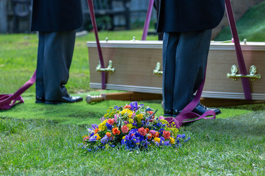 coffin and wreath at graveside