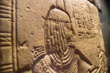 ancient egypt wall with woman. The ancient Egyptian art of hieroglyphs carving on stone.