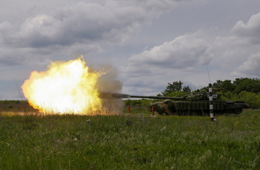 A tank, operated by servicemen of the self-proclaimed Donetsk People's Republic (DNR) fires during military exercises at a target range outside the town of Horlivka (Gorlivka)