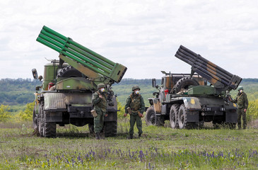 Servicemen of the self-proclaimed Donetsk People's Republic (DNR) stand next to Grad multiple rocket launcher systems during military exercises at a target range outside the town of Horlivka (Gorlivka)