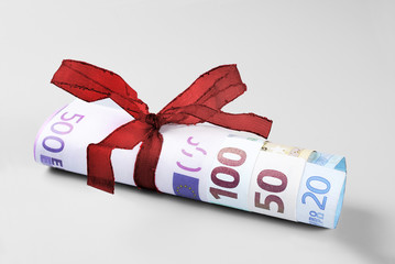 Rolled Twenty to Five Hundred Euro Banknotes with Red Ribbon