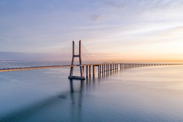 Portugal, Lisbon, Vasco da Gama Bridge at moody sunrise