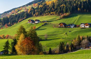 Autumn Santa Magdalena famous Italy Dolomites mountain village environs hills.