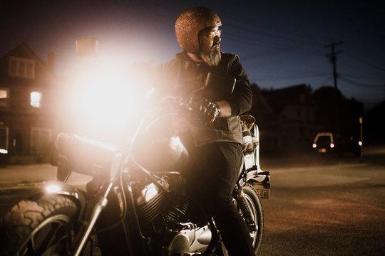 Man on motorbike at night