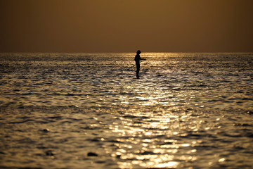 A man rows in the water of the Meditarenean sea in Tel Aviv as coronavirus disease (COVID-19) restrictions ease in Israel