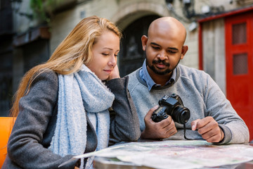 Portrait of couple looking at map, Barcelona, Spain