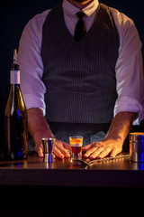 Bartender making B-52 cocktail