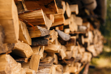 Closeup of chopped firewood in a stack ready for burning.