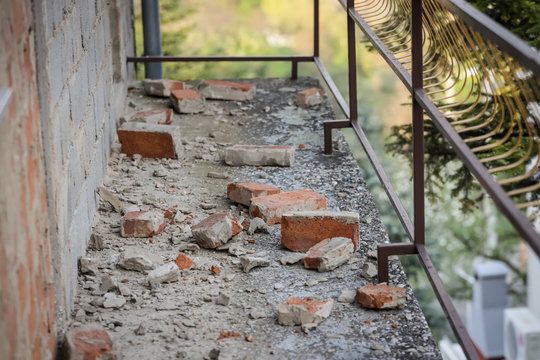 Scattered and damaged bricks on the balcony