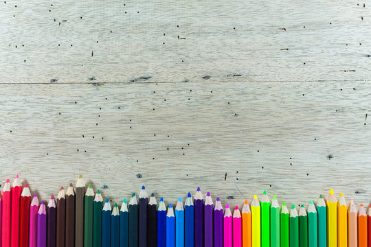 Directly Above Shot Of Colored Pencils On Wooden Table