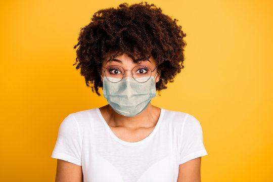 Close-up portrait of her she nice cute lovely pretty attractive wavy-haired lady save covid-19 infection wearing medical mask white t-shirt isolated over bright vivid shine background
