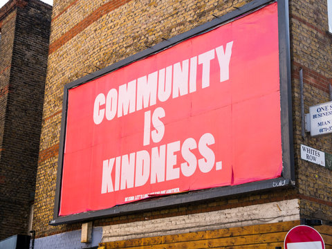 "London lockdown, 21st May, 2020. East London, UK. ""Community is kindness"". Advertising billboard campaign poster to boost morale of Londoners during lockdown. Covid-19 pandemic. Coronavirus."