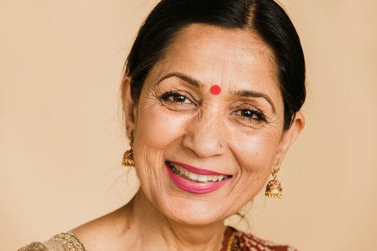 Happy Indian woman wearing a bindi