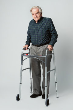 Senior man using a zimmer frame