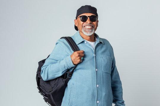 Cheerful senior black man wearing a cap and sunglasses