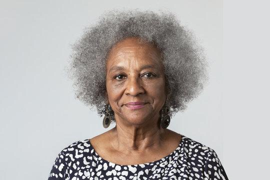 Happy black senior woman in a studio shoot
