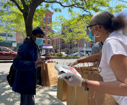 Volunteers at Salem United Methodist Church hand out grab-and-go meals from Rethink Food in New York