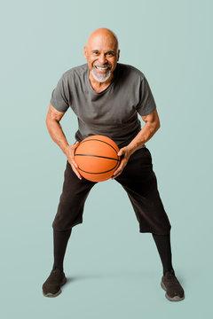 Retired man playing a basketball mockup