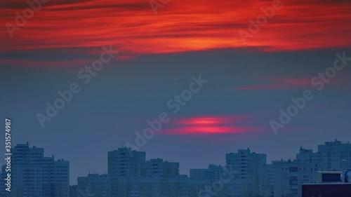 Fotobehang Sunset sun sky city buildings skyline silhouette, zoom in on windows light up, twilight to night change. Timelapse, 4K UHD