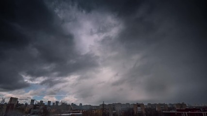 Fotobehang - Weather changing from rain storm clouds to bright sunny day passing over city skyline. Timelapse, 4K UHD.