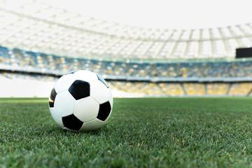 soccer ball on grassy football pitch at stadium