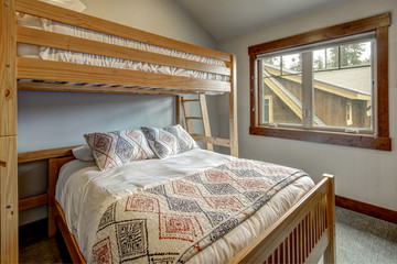 Small Guest bedroom interior with kids  bunk bed and soft grey walls