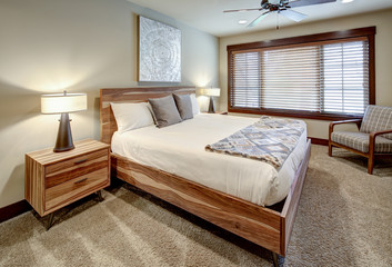 Bedroom interior with natural wooden modern furniture.