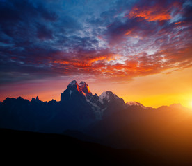 Wall Mural - Fantastic brilliant sunrise with rays illuminating the dark clouds. Location place of Mt. Ushba, Upper Svaneti, Georgia country.