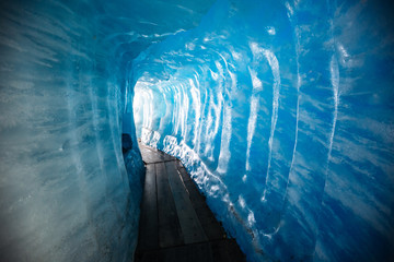 Wall Mural - Spectacular blue ice inside a glacier cave. Location place of Rhone glacier, Furkapass, Swiss alps.