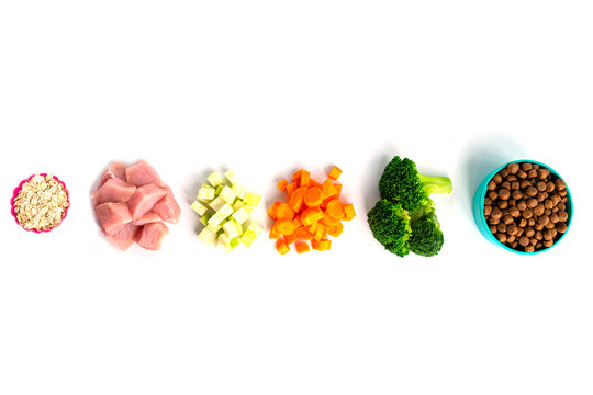 ingredients oat, meat, zucchini, broccoli, carrot for pet food natural on white background