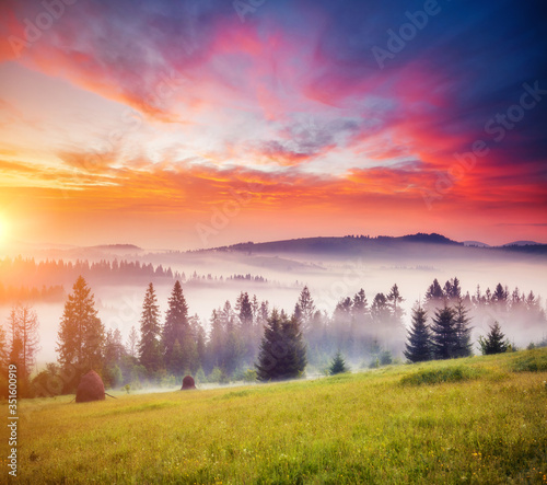 Wall mural Tranquil morning moment in alpine valley. Fantastic sunset scene.