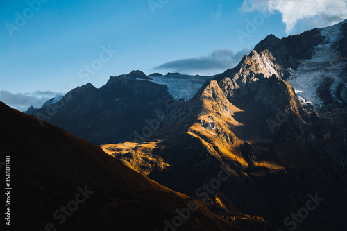 Wall mural Majestic mountains illuminated by the sun. Location Zemo Svaneti, Georgia country, Europe.