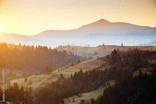 Wall mural Attractive morning moment in alpine countryside. Magical sunset.