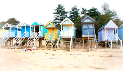 colorful wooden houses on the beach