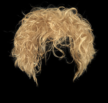 Curly blonde hair wig isolated on black background
