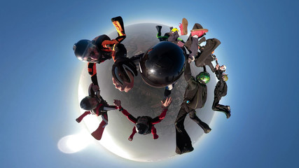 A parachuting team with a panoramic view from a 360 camera. Mini planet.