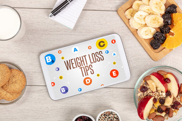 Healthy Tablet Pc compostion with WEIGHT LOSS TIPS inscription, weight loss concept