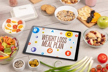 Healthy Tablet Pc compostion with WEIGHT LOSS MEAL PLAN inscription, weight loss concept