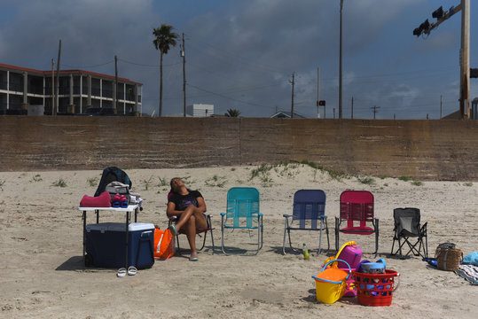 A woman sleeps on a beach chair after the coronavirus disease (COVID-19) restrictions were lifted at the beginning of May, at the start of the Memorial Day weekend in Galveston