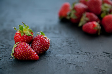 close-up strawberries on a dark background
