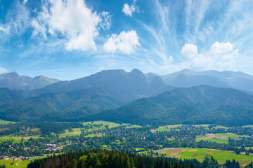 high tatra mountain ridge. poland travel destination. beautiful summer landscape in evening light. sunny weather with fluffy clouds on the blue sky.