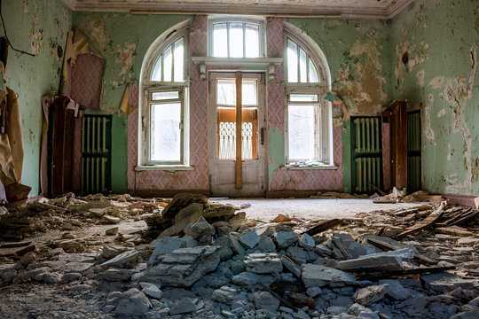 Collapsed stucco from the ceiling in the room of an old abandoned manor