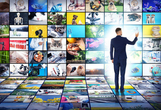 Media library concept. Man using virtual video gallery
