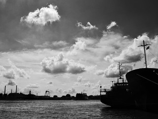 Fotobehang Schip Boats In River Against Cloudy Sky