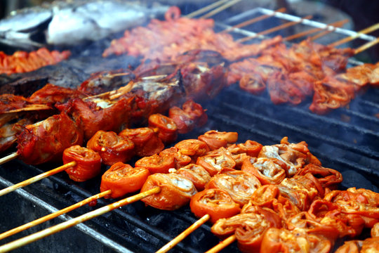 Assorted grilled pork and chicken innards barbecue at a street food stall