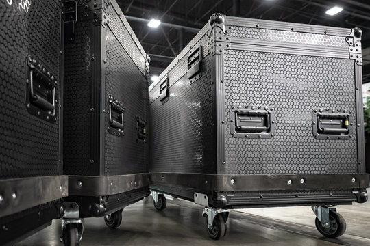 Concert equipment. Containers for transportation of equipment. Reinforced boxes on wheels. Containers with handles and wheels for easy transportation. Transportation of equipment for the stage.