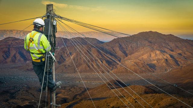 Engineer Repairing A Desert Telephone Line
