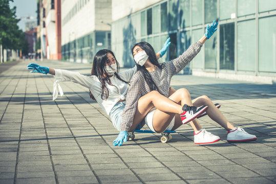 Two asian girls having fun outdoor after coronavirus lockdown