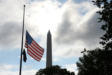 U.S. flag flies at half-staff on the National Mall to commemorate the victims of the coronavirus disease (COVID-19) in Washington