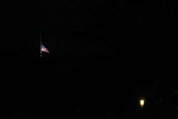 A U.S. flag lowered to half mast to honour the dead flies over the National Mall, largely empty of tourists during the coronavirus outbreak in Washington